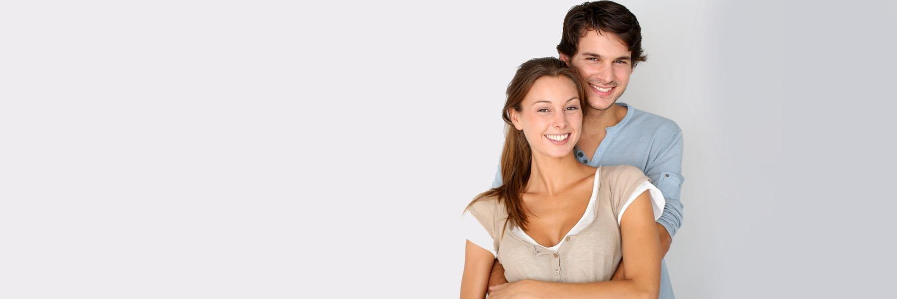 Young couple smiling & hugging l KOR Teeth Whitening NYC