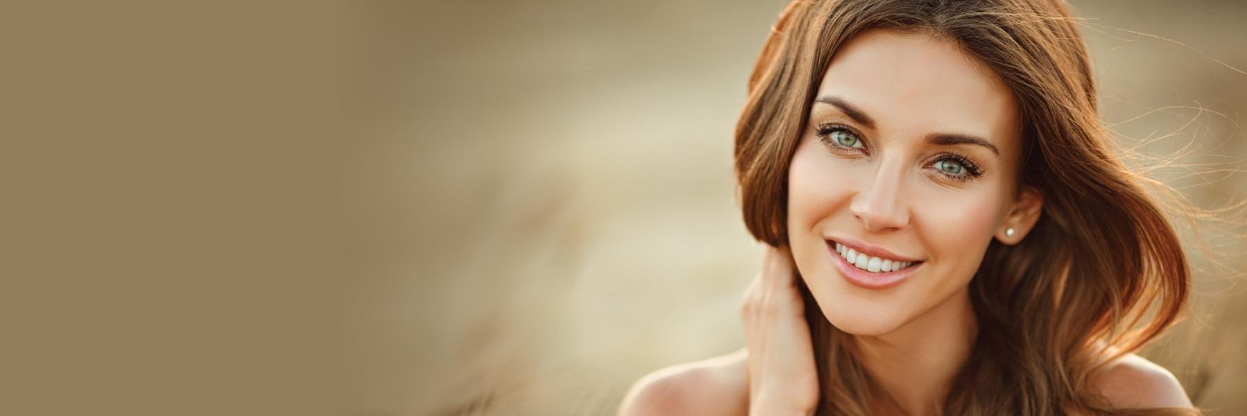Woman with brown hair smiling l Invisalign new york ny